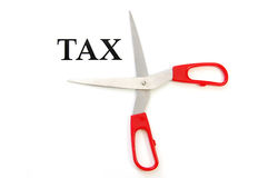 Cutting taxes. Getting ready to cut 'tax' with a pair of scissors royalty free stock images