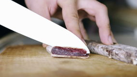 Cutting Thin Slices Of Salami stock video