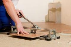 Cutting tiles Stock Image