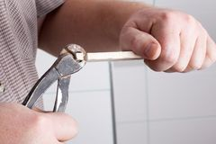 Cutting tiles Royalty Free Stock Image