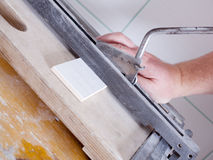 Cutting tiles Stock Photography