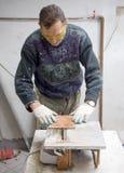Cutting tiles Stock Photography
