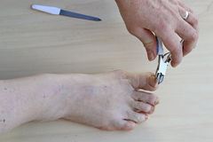 Cutting the toe nails Royalty Free Stock Image