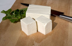 Cutting tofu on cutting board Stock Image