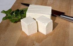 Cutting tofu on cutting board Stock Image
