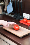 Cutting a tomato Royalty Free Stock Images