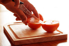 Cutting tomato Stock Image
