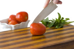 Cutting a Tomato Royalty Free Stock Photography