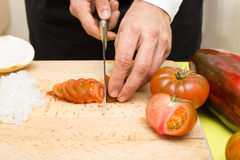 Cutting tomato Royalty Free Stock Photo