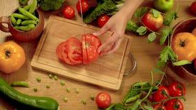 Cutting tomato stock video