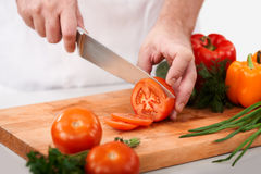 Cutting tomatoes Royalty Free Stock Photography
