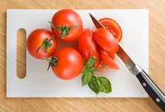 Cutting tomatoes Stock Image