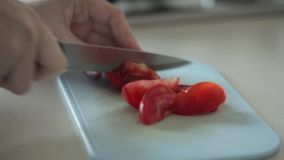 Cutting tomatoes for dinner stock video
