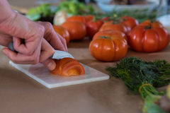 Cutting tomatoes royalty free stock photos