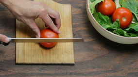 Cutting tomatoes Royalty Free Stock Image