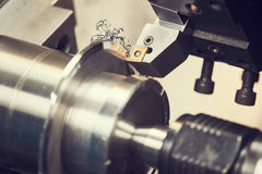 Cutting tool at metal working on lather machine Stock Photo