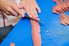Cutting tuna steak Royalty Free Stock Photography