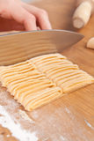 Cutting uncooked homemade egg pasta Stock Image