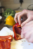 Cutting up bell peppers Royalty Free Stock Photos