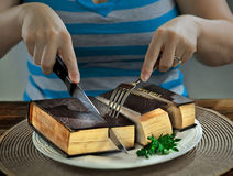 Cutting up a Bible. For eating at dinner Stock Photo