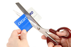 Cutting up a Credit Card. Cutting up credit card with scissors. Showing no more credit, or tired of using the credit from banks Royalty Free Stock Images