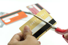 Cutting up credit card with scissors Royalty Free Stock Photo
