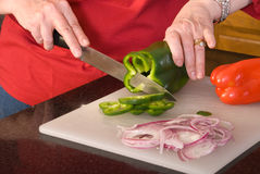 Cutting up vegetables. Stock Images