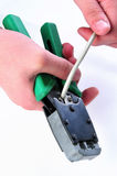 Cutting an utp cable with a network tool.Stages Of The Process Royalty Free Stock Image