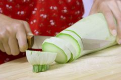 Cutting Vegetable Marrow Royalty Free Stock Photography