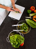 Cutting vegetables Stock Image