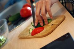 Cutting Vegetables Stock Photography