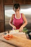 Cutting vegetables Royalty Free Stock Image