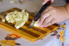 Cutting of vegetables on chopping board Royalty Free Stock Image