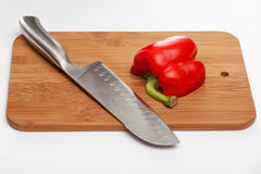 Cutting the vegetables with a kitchen knife on the board Stock Photography