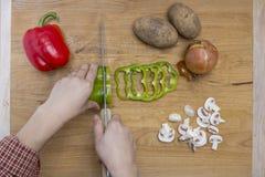 Cutting veggies on a cutting board royalty free stock image