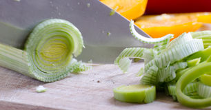 Cutting vegitables with knife Stock Images