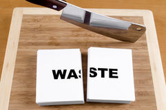 Cutting Waste. With a Cleaver and Cutting Board Royalty Free Stock Image