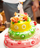 Cutting a wedding cake Stock Photography