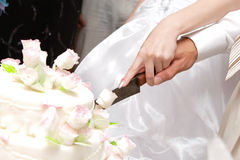 Cutting a wedding cake