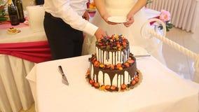Cutting wedding cake stock footage