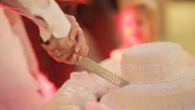 Cutting wedding cake stock video footage
