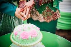 Cutting Wedding Cake Stock Images