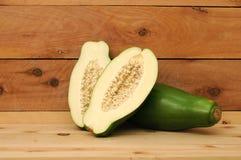 Cutting and whole green papaya Stock Photo