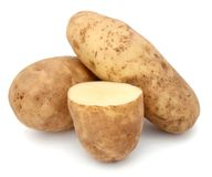 Cutting and whole potatoes Stock Images