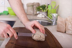 Cutting wholemeal bread Stock Photography