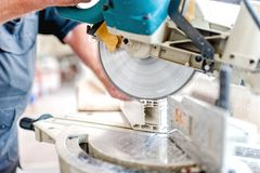 Cutting Window Frame Profile. Circular saw Stock Images