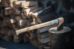 Cutting wood with ax, wood for winter royalty free stock images