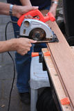 Cutting wood with circular saw Royalty Free Stock Photography