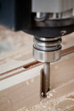 Cutting wood on CNC milling Royalty Free Stock Image