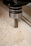 Cutting wood on CNC milling. Cutting wood with a CNC milling machines Stock Photography